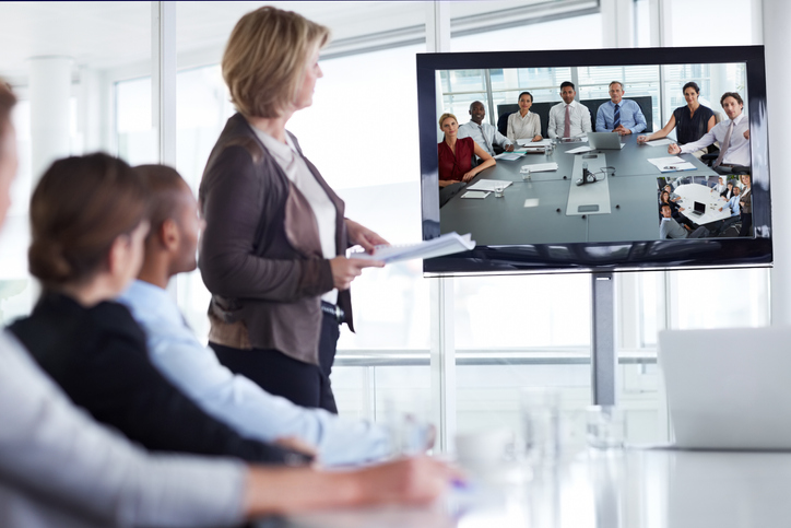 Businesswoman giving presentation in conference meeting